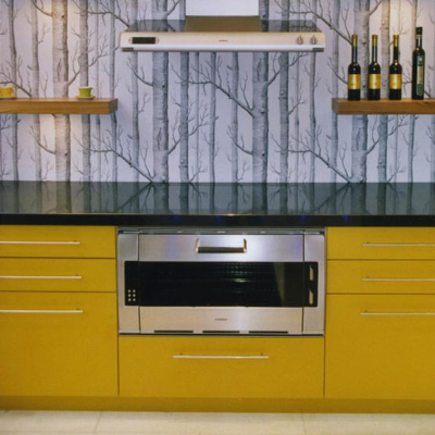 The linear grey pattern of the wallpaper tones down the bright yellow,